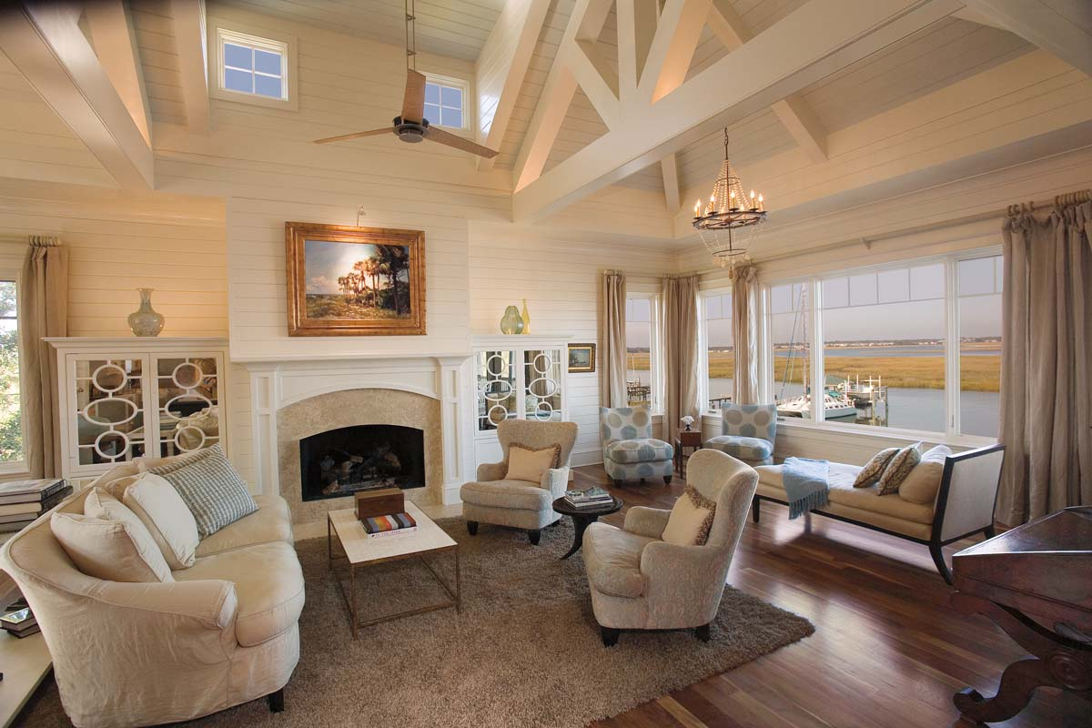 ... On The Walls And Ceiling, An Intricate Network Of Exposed Beams And  Windows Placed In The Highest Peak, This Living Room Offers A Perfect Blend  Of Beach ...